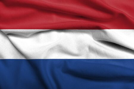 Realistic 3D flag of Netherlands with satin fabric texture. Standard-Bild