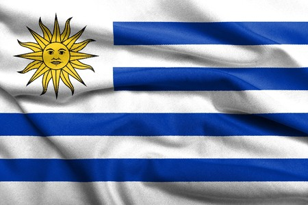 Realistic 3D flag of Uruguay with satin fabric texture. photo