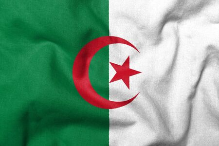 Realistic 3D flag of Algeria with fabric texture. Standard-Bild