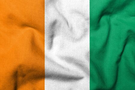 Realistic 3D flag of Cote d'Ivoire with fabric texture. Standard-Bild - 7055533
