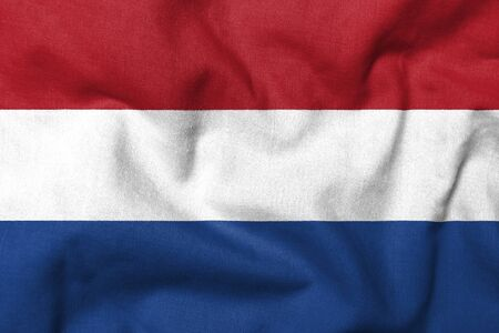 Realistic 3D flag of Netherlands with fabric texture. Standard-Bild