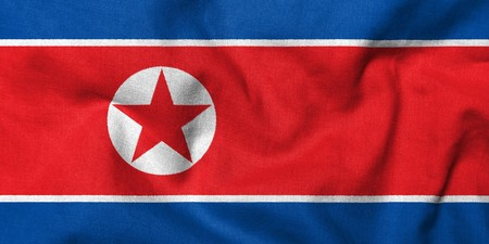 Realistic 3D flag of North Korea with fabric texture.