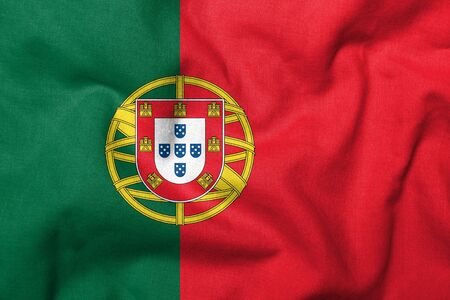 Realistic 3D flag of Portugal with fabric texture. Standard-Bild