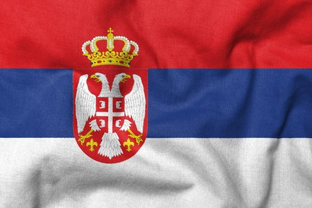 Realistic 3D flag of Serbia with fabric texture.