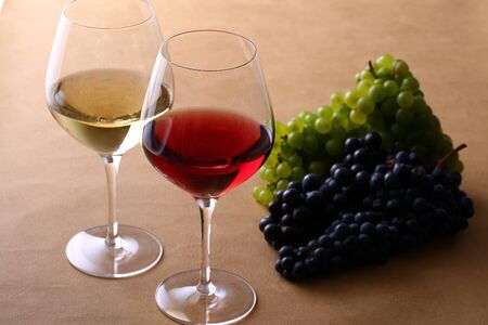 Two glasses of wine and grapes