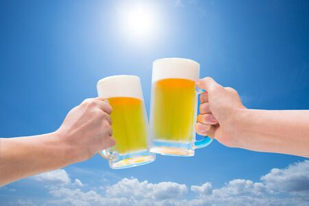 Toast with draft beer under the blue sky