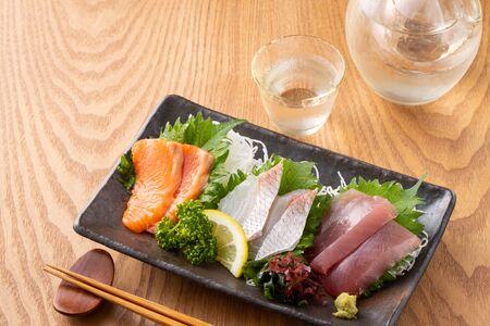 Assorted sashimi and cold sake 写真素材
