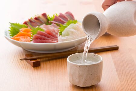 Assorted sake and sashimi