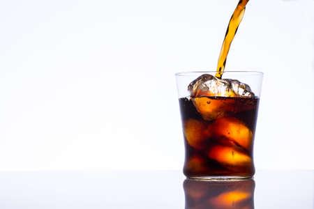 Pour the iced coffee Фото со стока