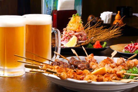 Assorted yakitori and beer from Japanese taverns