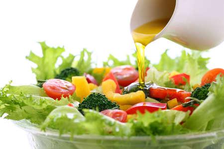 put dressing on a vegetable salad