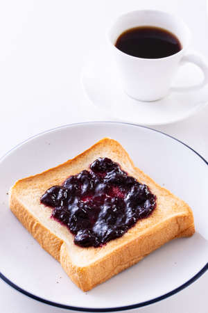 Toast and coffee with blueberry jam