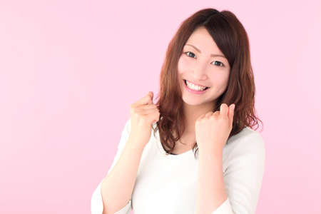 A young woman posing for guts