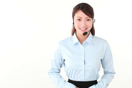 Young woman guiding at call center Stock Photo