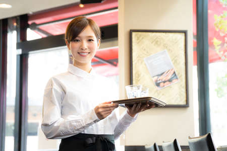 A girl working part-time at a café