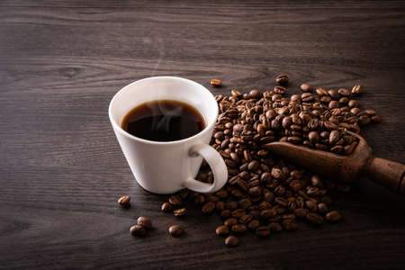 Hot coffee and coffee beans on the table