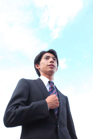 Blue Sky and Young Businessman