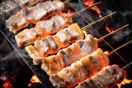 Yakitori is grilled at a yakitori restaurant in Japan.