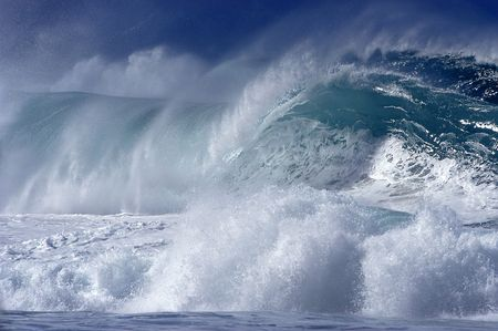 Wild surf crashing on the beach on the North Shore of Hawaii.                             Stock Photo