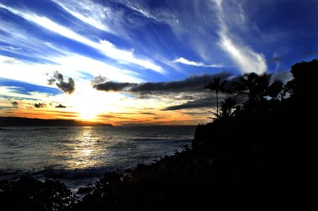 Hawaiian Sunset over looking a beautiful bay with blue skies in Hawaii