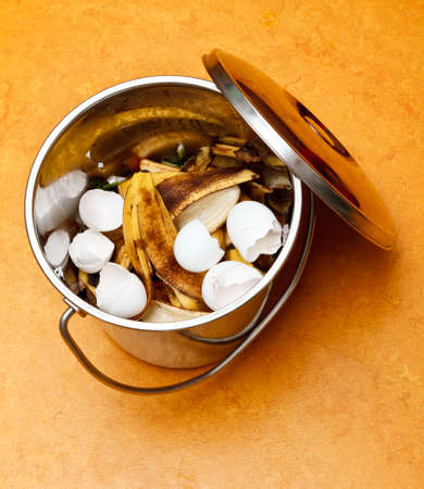 organic waste: Compost bucket with egg shells and banana peels Stock Photo