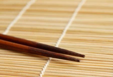 Sushi mat and chopsticks Imagens - 10654652