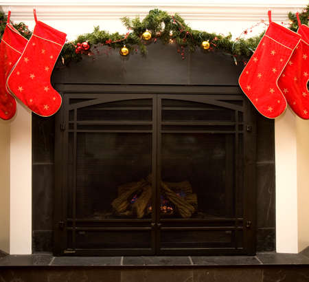 Christmas fireplace with decorated mantle photo