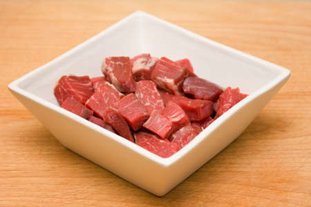 Cubed raw beef photo