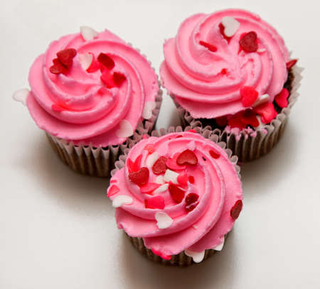 Pink cupcakes with heart sprinkles Stock Photo