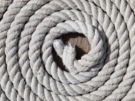 coiled rope: Rope coiled up on deck Stock Photo