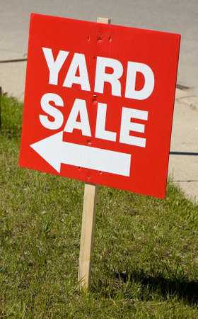 Yard sale sign on lawn Stock Photo