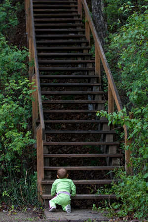 Baby at bottom of long staircase photo
