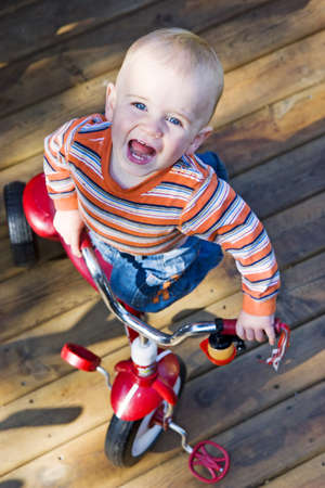 Boy on red tricycle Stock Photo - 10658181