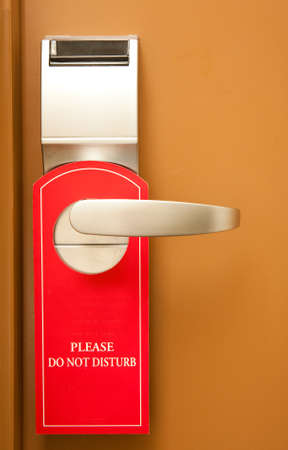 hotel room door: Do not disturb on hotel door Stock Photo