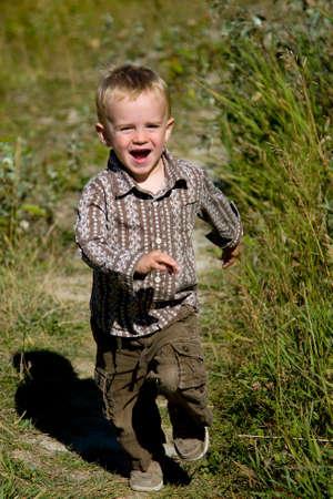 Happy boy running outdoors Stock Photo - 10658208