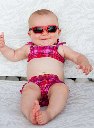 sunglasses beach: Baby in bikini at poolside