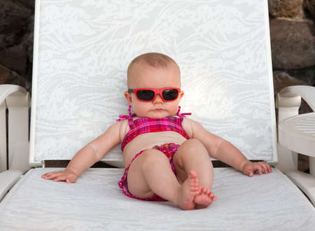 pink bikini: Serious baby on beach in bikini