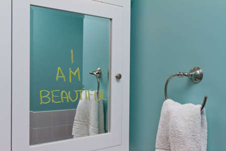 with reflection: Positive body image in mirror Stock Photo