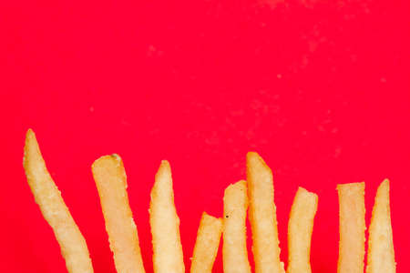 Fries on red background Stock Photo