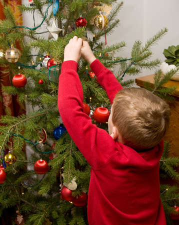 decorating christmas tree: Child decorating Christmas tree Stock Photo