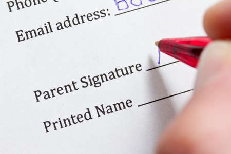 consent: Signing parental consent form Stock Photo