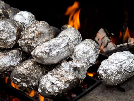 Baked potatoes on camp fire