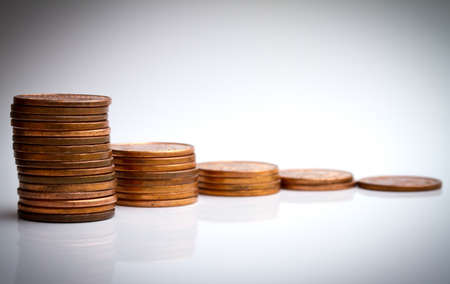 compound: Coin piles compound interest Stock Photo