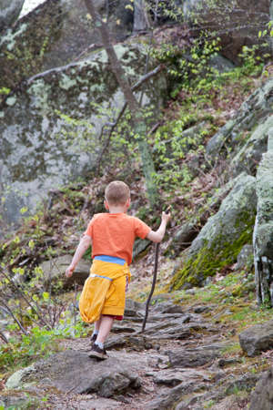 Boy hiking in nature outdoors Stock Photo - 10750404