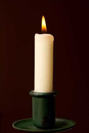 Candle lit in holder Stock Photo - 10750345