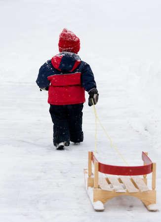 Boy pulling sled Stock Photo - 10750521