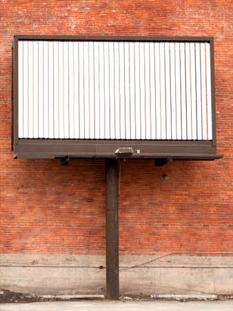 Three state rotating billboard against brick wall with blank message