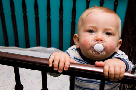baby crib: Baby with pacifier