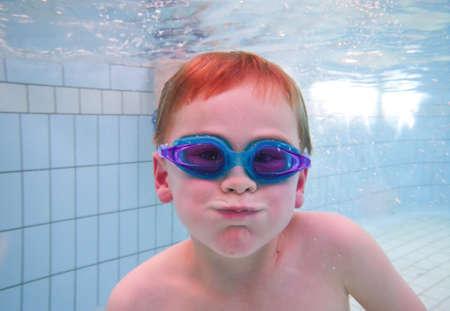 Boy swimming in pool photo