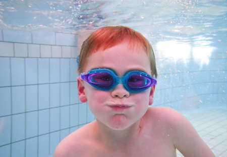 Boy swimming in pool photo
